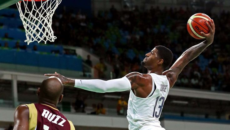 Basketball-Men's Team-Preliminary Round USA vs VEN:   United States guard Paul George dunks the ball against Venezuela during the men's basketball preliminary round in the Rio 2016 Summer Olympic Games at Carioca Arena 1.