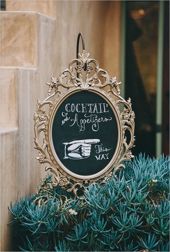 gold framed chalkboard cocktail wedding sign | Casablanca Wedding Dress for a Shabby chic wedding with blush and champagne colours Photographed by: laurenscotti.com | read full #wedding on fabmood.com::