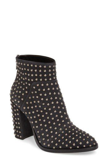 Regimented rows of polished dome studs pepper every inch of a block-heel bootie perfect for showing off under cropped hemlines.