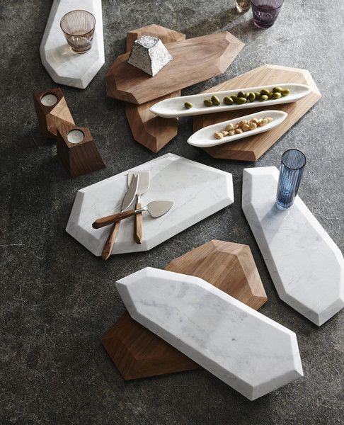 These sensational angular marble and rosewood board present a new edge for serving cheeses and other festive hor d'ouerves. The marble boards are hand-cut from