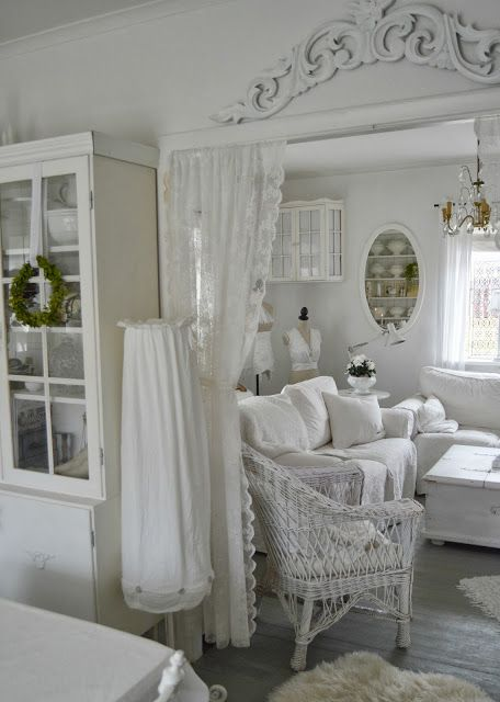 Shabby Chic. Use a pediment or frieze over a door. You can find similar carved wooden pieces at www.buycarvings.co.uk