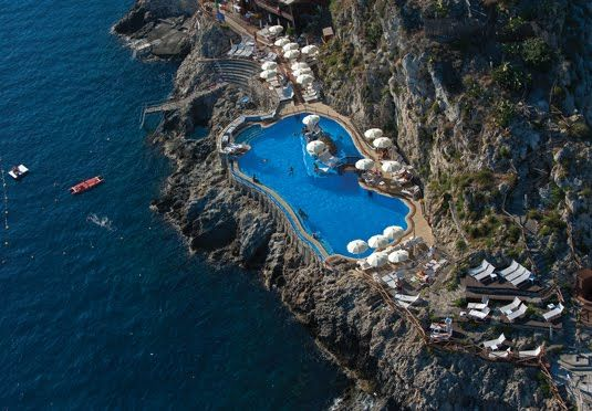 Seven nights at a charming hotel in Taormina, featuring breathtaking views of Mount Etna and the Bay of Naxos