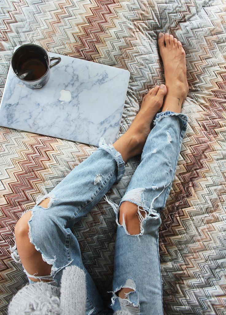 ripped jeans / marble laptop case