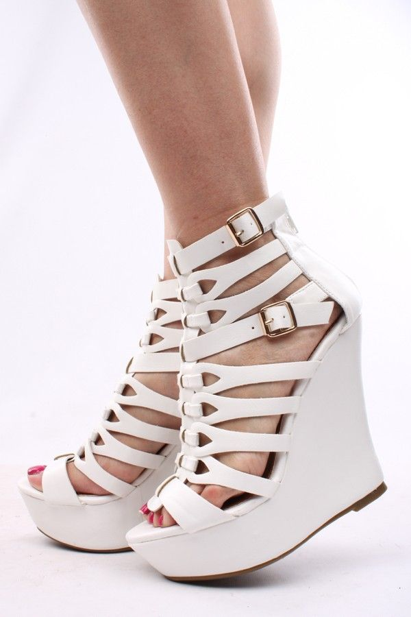 c2c4647fb242 Crinkled faux leather upper in a platform wedge style with a round open toe