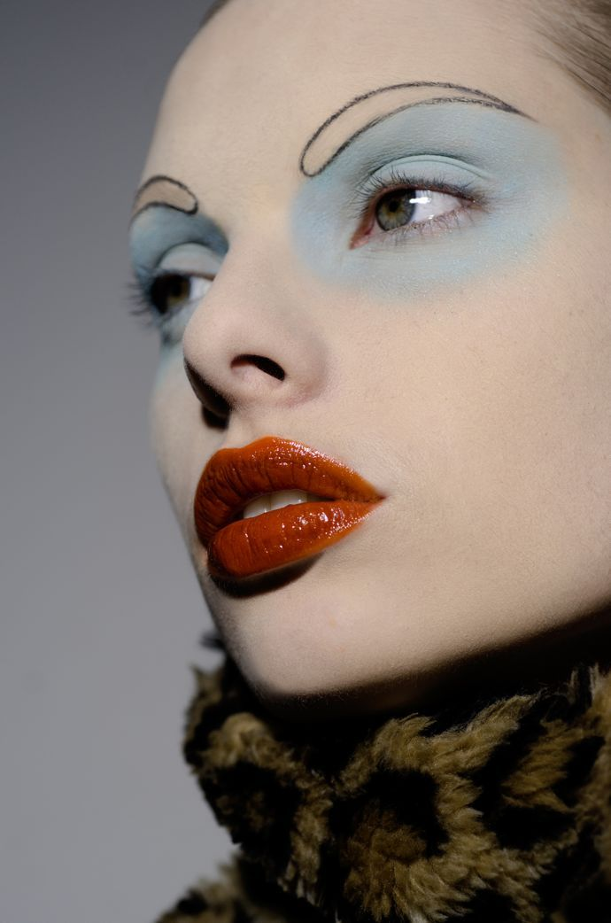 Pale Blue Eyeshadow, Outlined Hollow Eyebrows, and Red Gloss Lips.