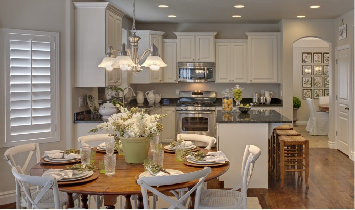 """White is """"in""""! But make sure you use hardwoods and fixtures that compliment the white."""