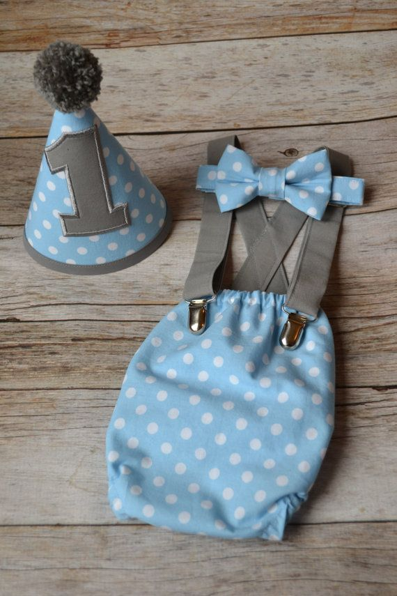 Boy cake smash outfit in Baby Blue with white polka dots and Gray accents! Not only is it a perfect cake smash outfit, it is also great for 3 months, 6 months or 9 months milestone photo shoots. The tie is also great for a wedding, festive event, holiday or for your Sunday best. The ties are pre-tied with an adjustable velcro closure. Each of my sets is made from beginning to end by me with exceptional attention to detail so that your little boys big day is as perfect as you dreamed it to…