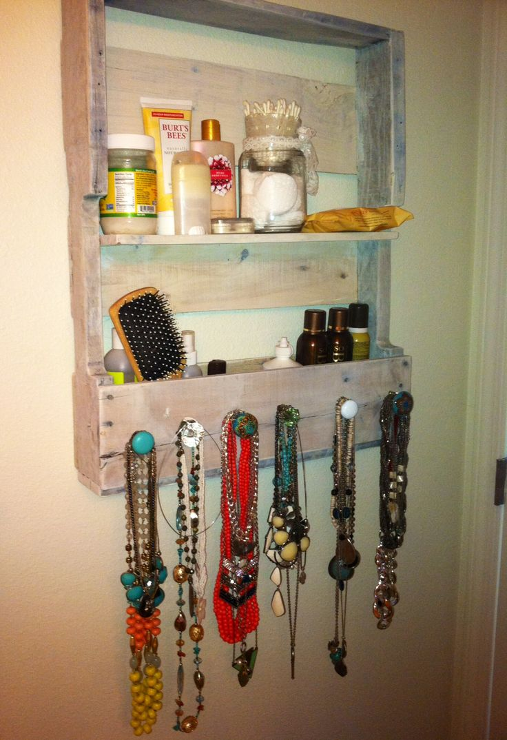 Shelf and jewelry holder I made from reclaimed pallet wood.
