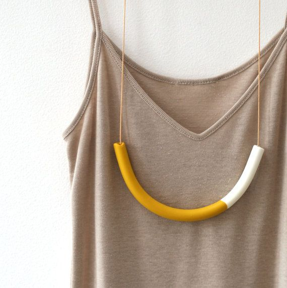 Rachel Wightman,creator of notTuesday. This necklace features a handmade polymer clay bead/pendant in a mustard yellow and white combination. Length of the bead is around 22cm (measured around the outside). It is strung on 90cm of waxed cotton cord. Looking at other items on this etsy shop this piece must have been priced between $ 50.00 and $ 75.00