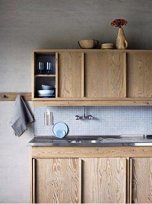 Kitchen cabinets with sliding doors in a scandinavian kitchen by Irina Graewe http://www.irinagraewe.de