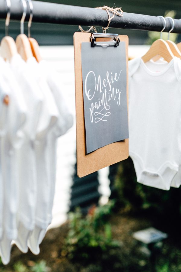 Onesie painting baby shower station: http://www.stylemepretty.com/living/2016/06/08/unique-boho-baby-shower/ | Photographer: M&Him Photo & Video - http://www.mandhim.com/
