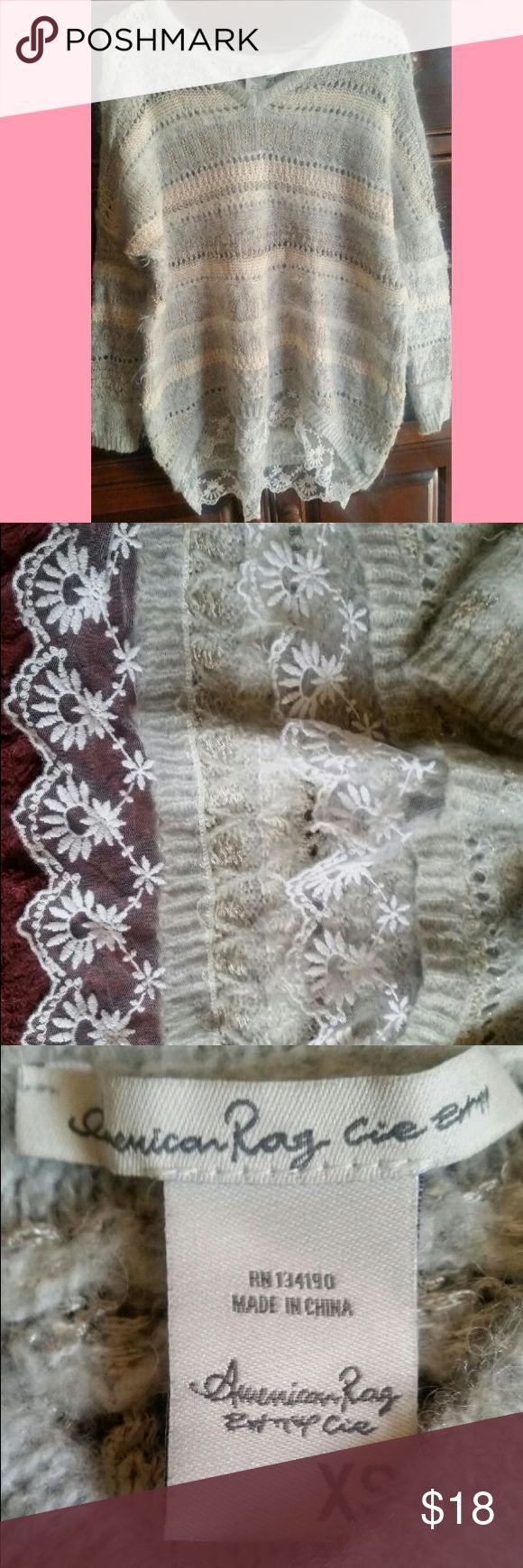 American Rag Sweater Size XS, lace trimming at the bottom, worn once, oversized American Rag Sweaters