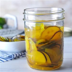 Sweet and Sour Zucchini Pickles Recipe -To use up all those green beauties in your garden, make these unexpected pickles. Preserve them now to share as a holiday gift from your kitchen. —Tina Butler, Royse City, Texas