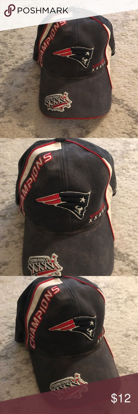 Blue & red New England Patriots Super Bowl hat Faded, pale blue microfiber hat with white and red trimming by Reebok for the NFL football team New England Patriots. The hat has the Patriots logo on the front and Super Bowl XXXVI Champions on it with the Super Bowl United States country flag logo on the brim of it. The hat has an adjustable Velcro strap on the back, and is designed to be one size fits all. 100% cotton. The hat has some water discoloration on it, but besides that is in good…