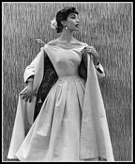 Marie-Hélène in pink cyclamen piqué dress, fitted bodice bares the shoulders and falls into a full skirt, matching coat is lined cashmere print, by Manguin, photo by Pottier, 1955   by skorver1