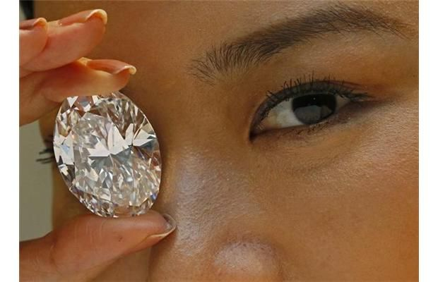 FILE - In this Thursday, Sept. 19, 2013 file photo, a 118.28-carat white diamond is displayed by a model at a press preview at Sotheby's auction
