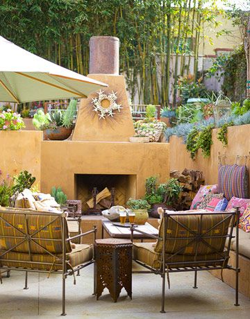 Southwestern flair is mixed into this cozy sitting area — the Mexican lounge chairs are covered in a festive variegated stripe with embroidery-like embellishments. Click through for more outdoor upholstery fabrics.