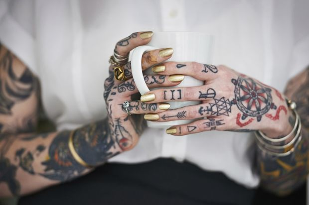 Heavily tattooed women struggle with gender norms, job discrimination, family rejection. Here's why they face it