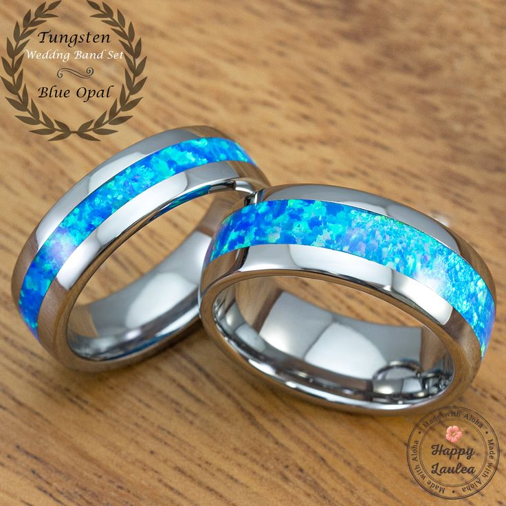 This tungsten ring set is beautifully inlaid with the blue opal which is  known to be a stone representing hope, innocence and purity. Opal stones  are among the visually most attractive gemstones. The internal structure of  precious opal makes it diffract light; depending on the conditions in which  it formed, it can take on many colors.   Perfect for occasions such as weddings or anniversaries, the tungsten  carbide ring with Hawaiian koa wood inlay symbolizes a new promise to your…