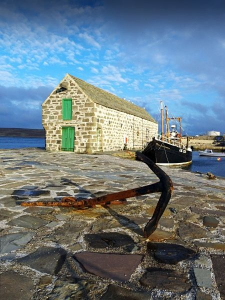 Pier in Lerwick, Shetland Islands, Scotland. Lerwick is the capital and main port of the Shetland Islands, Scotland, located more than 100 miles off the north coast of mainland Scotland on the east coast of the Shetland Mainland.