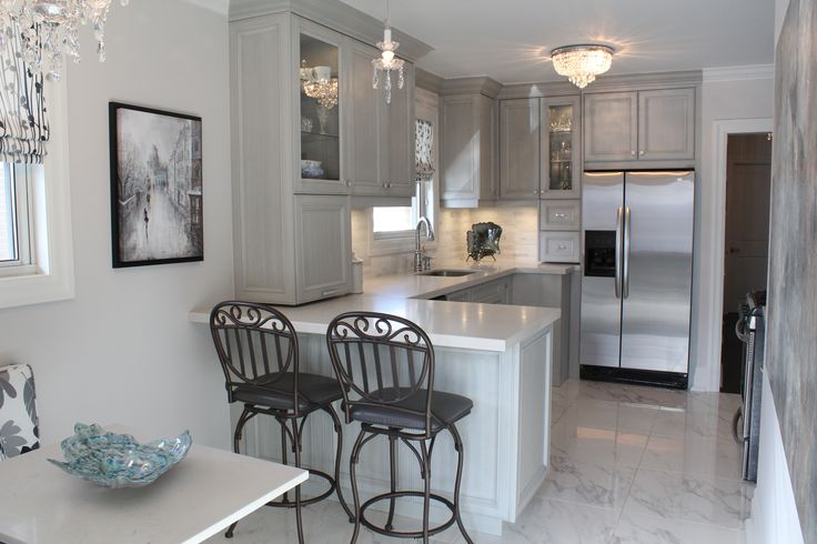 Stunning grey kitchen.  Who says you can't have bling in a kitchen even the handles have rinestones
