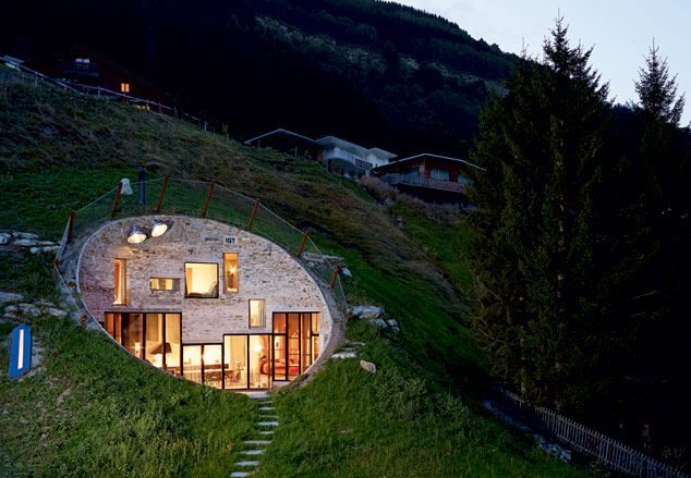 Odd house built into hillside.... Switzerland