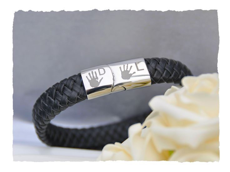 This leather braid bracelet is a fashionable way to capture your loved one's print and is perfect for men or women.  We will engrave prints with an initial on each side of the clasp.  Choose to have hand or foot prints engraved.