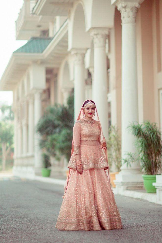599c0337f80f0 Pretty peplum blouse with light peach lehenga for wedding. See more on  wedmegood.com  wedmegood  indianwedding  indianbride  pastel  pastellehenga  ...