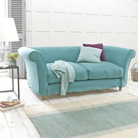 """CHESTER SOFA with removable cover. We've updated the traditional Chesterfield sofa with fewer buttons and cleaner lines and then we've added our own lovely weathered oak legs. """"Champion!"""" as our Derbyshire sofa-makers say. #sofa #removablecover #livingroom"""