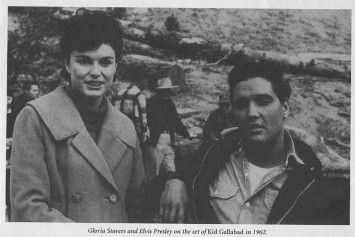 """Gloria Stavers and ELVIS on the set of """"Kid Galahd"""" in 1962. - - - - - Gloria Stavers was a young fashion model in 1957 when she took a job at 16 Magazine as a subscription clerk. While to most of the world Gloria Stavers is an unknown, she was ostensibly the first female rock journalist and her influence is still felt to this very day. Countless fan magazines, to include entertainment types as People and Us, have her to thank for setting the bar a high as she did."""