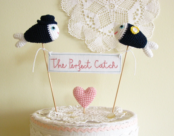 The Perfect Catch Nautical Navy Blue Wedding Cake Topper We Got Hooked  by Cherrytime. $59.00, via Etsy.