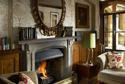 The Manor House Library - perfect for a spot of afternoon tea, pre-dinner drink or to snuggle up in front of the fire with a good book.