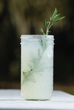 Mrs. Wilson's Rosemary Lemonade recipe courtesy James T. Farmer. 6 heaped teaspoons fresh rosemary plus additional sprigs for garnish. 2 cups sugar. Mix and boil for 10 minutes. Strain out rosemary. Add 9 cups water, 1.5 cups lemon juice, half teaspoon salt. Served ice cold. Garnish with rosemary sprig and sliced lemon.