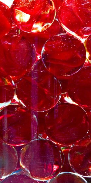 Red marbles drowning in a glass sea.