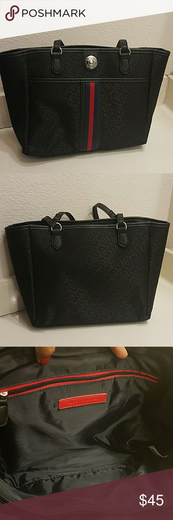 Tommy Hilfiger purse Tommy Hilfiger purse  Like new.. super clean and no stains or tears  Color Black whit the Tommy Hilfiger logo in the front. Tommy Hilfiger Bags Shoulder Bags