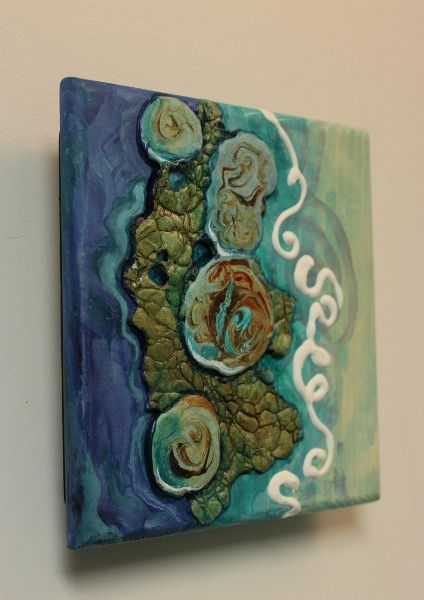 """""""Tidepool 2"""", 5x5 mixed media by Carol Nelson (2015) has several mixed media techniques in it, the bumpy background """"rocks"""" are made from prepared tyvek. The larger marbled rocks are a mixture of Plaster of Paris, Elmers Glue, and vinegar. The white squiggle is dimensional paint by Tulip."""