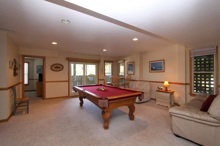 """http://www.vrbo.com/295082 The """"game room"""" with full size pool table, TV and mini-kitchen. Lots of hanging out and laughs happen here."""
