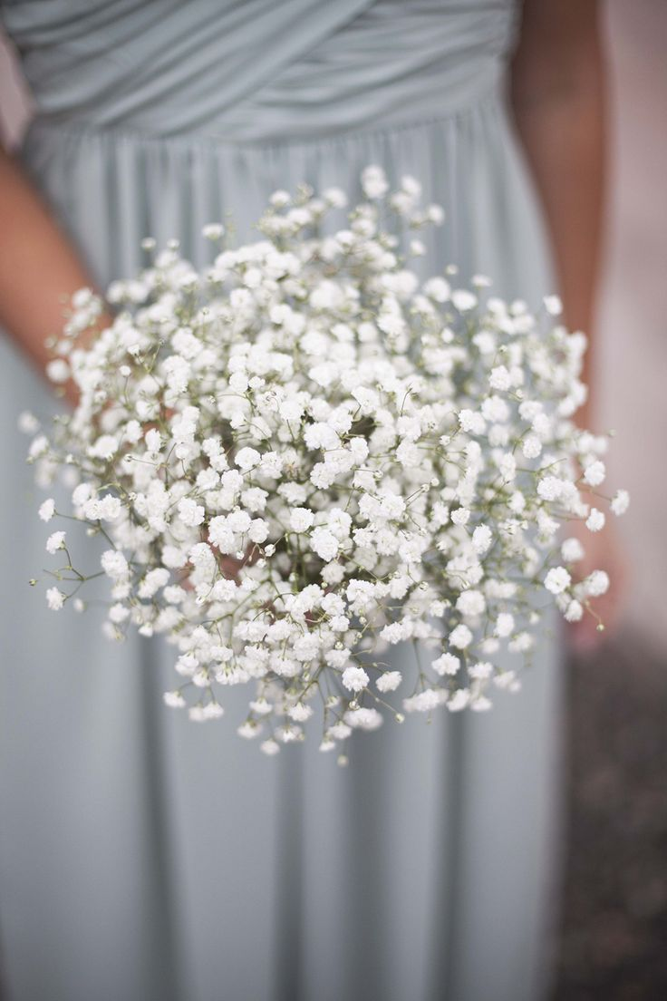 Bridesmaid with bouquet of Baby's Breath  Sara och Albin, a fun, whimsical Swedish wedding at the barn of Näs Gård, Sweden