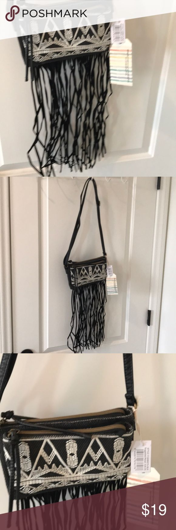 T-Shirt & Jeans crossover bag with black fringe T-Shirt & Jeans crossover bag with black fringe along bottom NWT Original price $49 9 X 6 inches T-Shirt & Jeans Bags Crossbody Bags