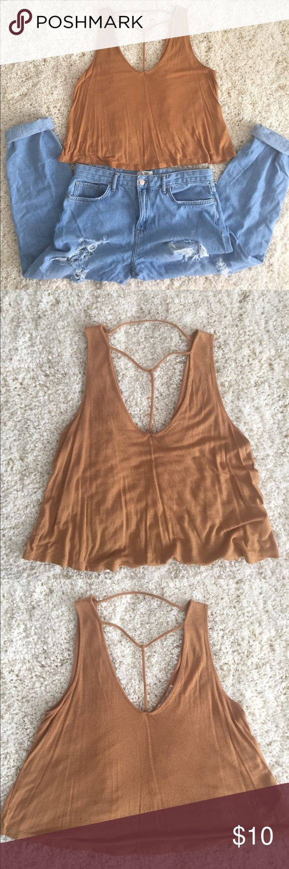 forever 21 • brown strappy top forever 21 • brown strappy top. T shaped strappy design in front. Simple & chic top! Dress it up or down. Size medium. Minor piling. It's a crop style for me, I'm 5'7. Forever 21 Tops Crop Tops