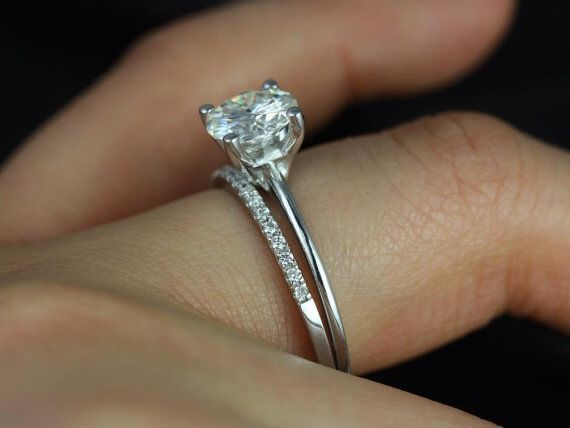 """Something to say, """"Yes!"""" to. {Engagement ring.} Thin band, single diamond (round, or princess), at least 1ct. Thin prongs."""
