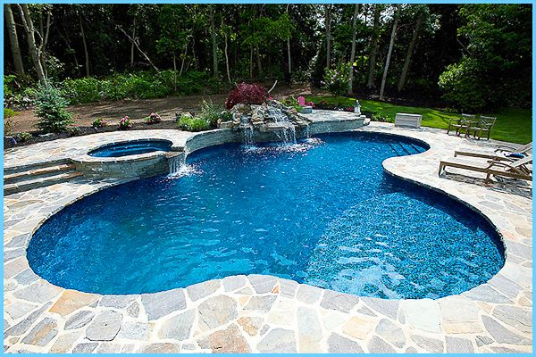 In another example of under-vinyl ledges and steps, this freeform vinyl pool was built by Swimming Pools by Jack Anthony. Award winning design also used a ...