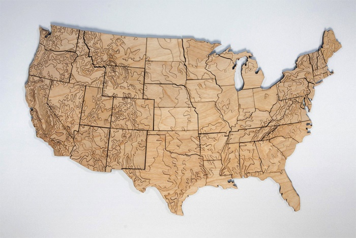 """""""The 54-40 packaging project was a collaboration between two sole proprietors: Mette Hornung Rankin of the Bureau of Betterment and Greg Jones of Fifty-Four Forty. Greg had the idea to create a set of magnetic-backed US states made out of laser cut wood that show the topography of America. After meeting at an ADX Feedback Loop event, Mette and Greg decided to collaborate on packaging prototypes for the first batch of products he wanted to sell to gather interest in his idea."""": Laser Cut Wood, Topographic States, States Magnets, Lasercut, Topographic Maps, U.S. States, Cut Outs, Bureau, United States"""