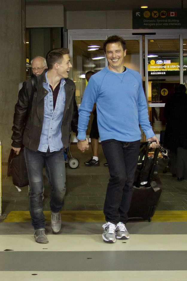 Colton Haynes And John Barrowman Hold Hands At The Airport - BuzzFeed Mobile