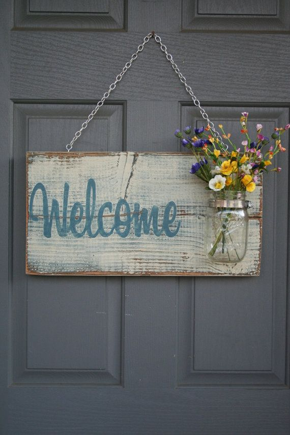 Hand Painted Welcome sign that is made for outdoor use. Includes a chain for hanging as well as a mason jar (Does not include flowers). I can do any
