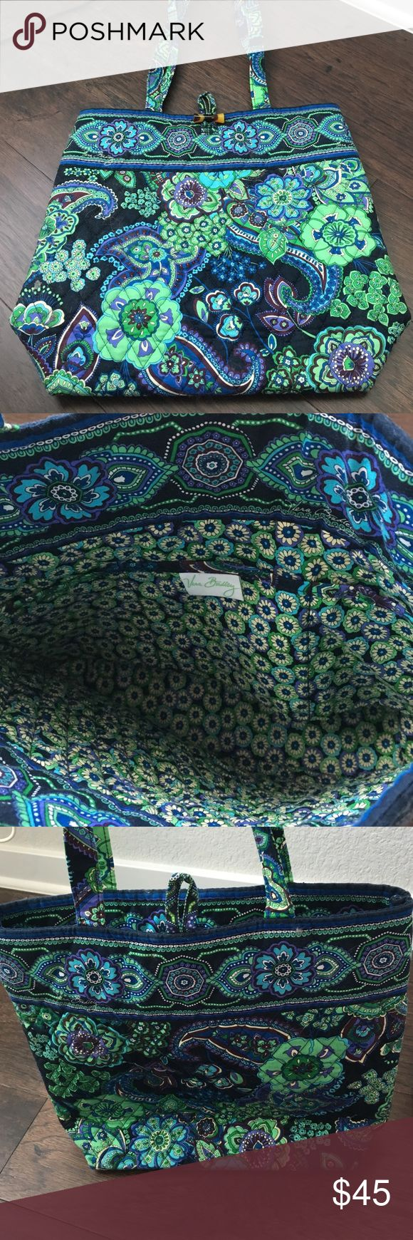 Vera Bradley tote in Rhythm and Blues Like new Vera Bradley tote in retired rhythm and blues pattern. Beautiful bright green, blues, and purples in paisley style pattern. Perfect for fitting a small laptop or a few notebooks. Tortoise shell style connector at top. Does not even look worn at all. Willing to find a price that works for you! Vera Bradley Bags Totes