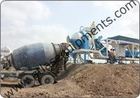 Portable RMC plant with reversible drum mixer