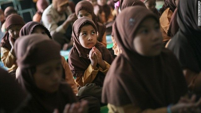 Elementary school students pray for the missing passengers during class in Medan, Indonesia, on March 15.