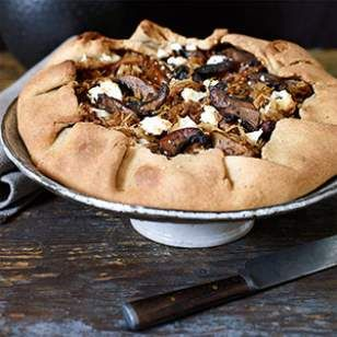 In this gorgeous vegetarian galette recipe, caramelized cabbage, earthy mushrooms and salty queso fresco (a soft, fresh Mexican cheese also known as queso blanco) are layered and wrapped within a peppery, flaky pastry crust.