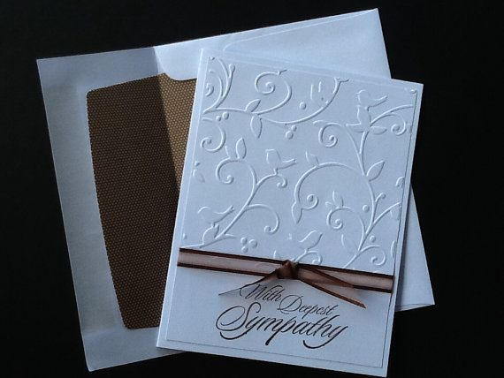 A sympathy card to convey your condolences to someone you card about. The card is embossed with gentle swirls and birds and is mounted on